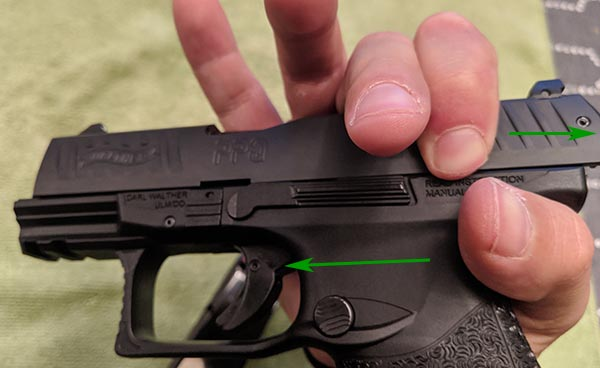 Step 3: Overhand grip on PPQ for disassembly