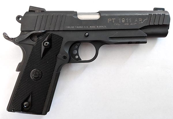1911 model full size handgun chambered in 45 auto for concealed carry