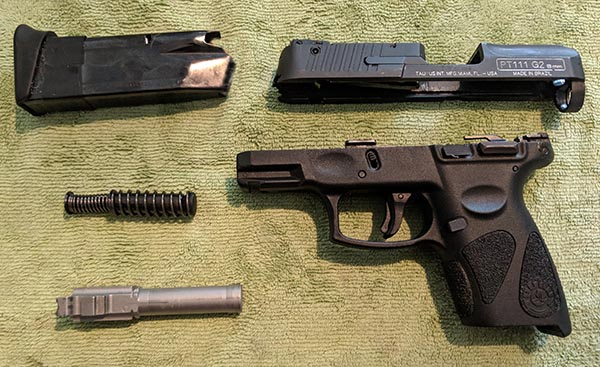 inspecting a new gun with a thorough field strip