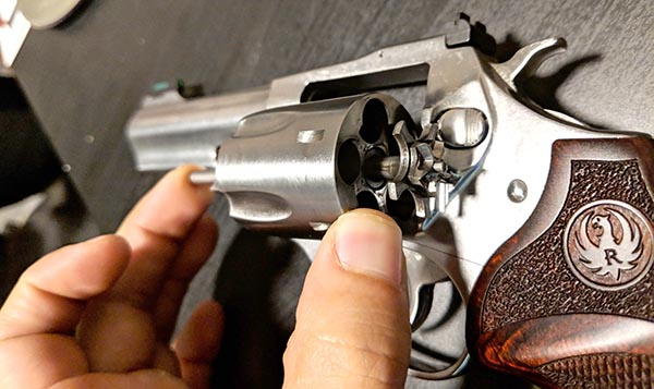 inspect action on a new revolver including ejector rod