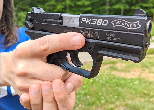 pk380 in small hands of female shooter