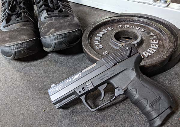 concealed carry while exercising - weight plates, shoes, and pistol