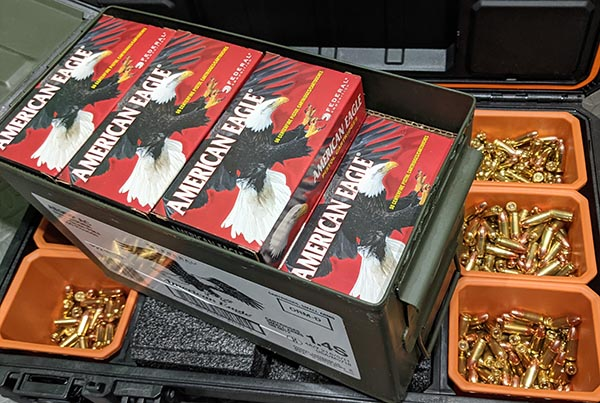 loose cartridges and boxed ammunition in ammo can
