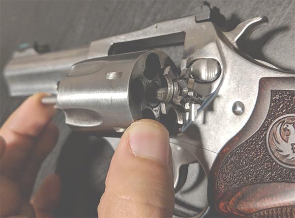 da revolver with cylinder and ejector on display