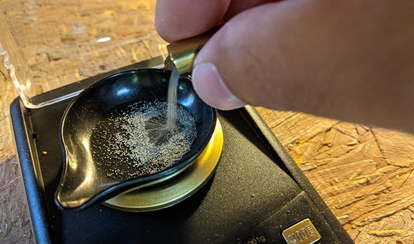 measuring the powder for 9mm reload