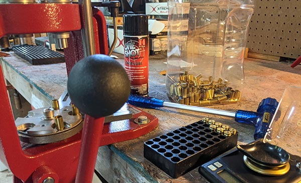 reloading press and other supplies for reloading handgun ammunition